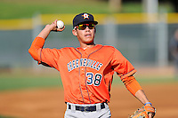 Third baseman Kristian Trompiz (38) of the Greeneville Astros warms up before a game against the Bristol Pirates on Saturday, July 26, 2014, at DeVault Memorial Stadium in Bristol, Virginia. Greeneville won, 2-1 in Game 1 of a doubleheader. (Tom Priddy/Four Seam Images)