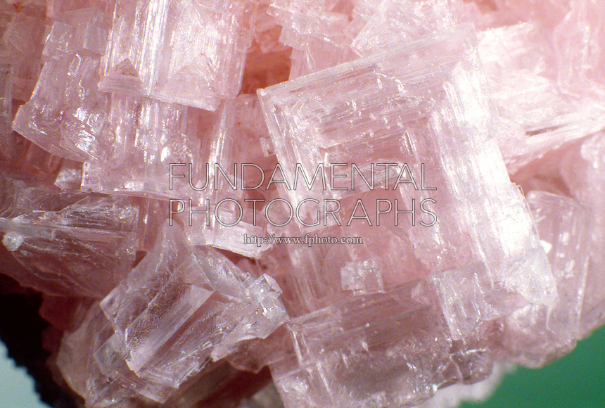 HALITE CRYSTALS - ROCK SALT<br /> NaCl<br /> Specimen shows cubic-hexoctahedral crystal formation<br />  Important sedimentary rock formed through precipitation from evaporating sea water, called evaporite.