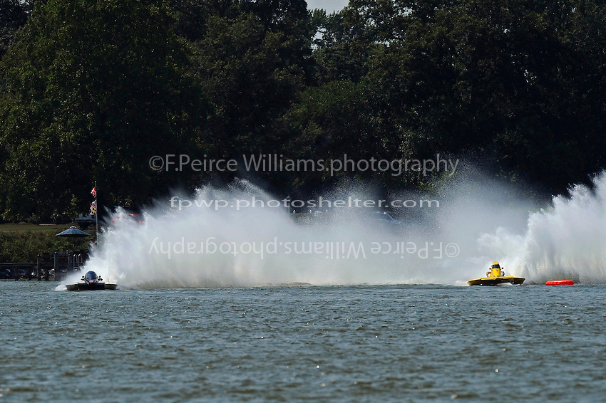 "End of second lap, final heat: Chuck Miller, Jr., NM-200 ""Mrjr's Lauterbach Special"" and Thom Heins, NM-30 ""Pennzoil Big Bird"" (National Mod hydroplane(s)"