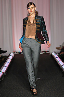 Model walks runway in an outfit by Leilani Maldonado, for the Syracuse University, College of Visual and Peforming Arts 2011 Fashion Show Gala.