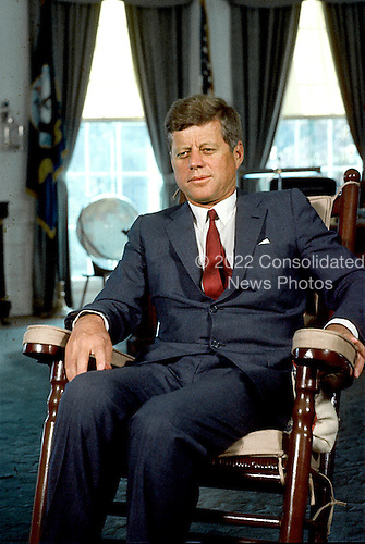 Washington, D.C. - Undated File Photo c. 1963 -- United States President John F. Kennedy sits in his rocking chair in the Oval Office of the White House in Washington, D.C. .Credit: Arnie Sachs - CNP