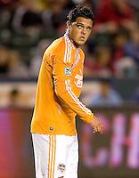 Houston Dynamo forward Luis Landin (7) makes an entrance. The Houston Dynamo defeated CD Chivas USA 2-0 at Home Depot Center stadium in Carson, California on Saturday May 8, 2010.  .