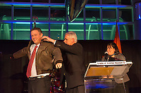 Feb. 27, 2013 - Garden City, New York, U.S. -  TODD R. RICHMAN (left), who is honored with the Donald E. Axinn Community Service Award, receives a flight jacket from ANDREW PARTON (center) the Executive Director of Cradle of Aviation Museum and LINDA ARMYN (right) Chair of the Board of Trustees of the museum, at the 10th Annual Cradle of Aviation Museum Air & Space Gala, celebrating the 40th Anniversary of Apollo 17.