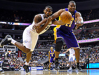 Hilton Armstrong of the Wizards tries to poke the ball away from Lakers' Andrew Bynum. Los Angeles defeated Washington 103-89 at the Verizon Center in Washington, DC on Tuesday, December 14, 2010. Alan P. Santos/DC Sports Box