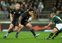 Ma'a Nonu runs at Springboks halfback Ricky Januarie with Owen franks in support. Investec Tri-Nations - All Blacks v South Africa at Westpac Stadium, Wellington on Saturday 17 July 2010. Photo: Dave Lintott/lintottphoto.co.nz