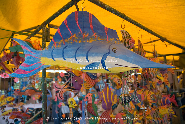 Colourful fishes in papier-mache hanging from a stall at the market, Havana, Cuba.
