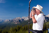 Kananaskis Country, Alberta, Canada, August 2008. A fire chief scans the forests for traces of smoke at his fire lookout in the mountains.  The Kananaskis is a tranquil and green part of the Rocky Mountains. Away from the masses it offers many outdoor adventure possibilities. Photo by Frits Meyst/Adventure4ever.com