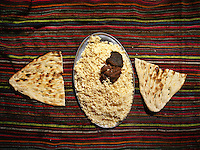 Rice dish names Pilaf or Pulau. Groom's house. In Imit (just past Khandut), wedding celebration of Tawakal Shoh with famous singer/dancer named Alowat..Wakhi wedding ceremonies only takes place in teh winter months. The Wakhi do most of their business with Afghan Kyrgyz..Winter expedition through the Wakhan Corridor and into the Afghan Pamir mountains, to document the life of the Afghan Kyrgyz tribe. January/February 2008. Afghanistan