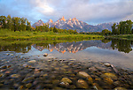 Wyoming. The Teton Range reflects in the Snake River at dawn, as it flows through Grand Teton National Park in summer.