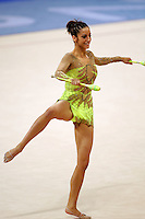 Almudena Cid of Spain turns fouette with clubs at 2004 Athens Olympic Games during All-Around final on August 29, 2006 at Athens, Greece. (Photo by Tom Theobald)