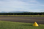 Alotau, Milne Bay, Papua New Guinea; taxi way cones, Gurney Airport Milne Bay, airport named after Bob Gurney, RAAF pilot killed in action during World War II, May 2, 1942 , Copyright © Matthew Meier, matthewmeierphoto.com