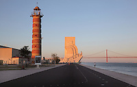 Old Belem Lighthouse, the Padrao dos Descobrimentos or Monument to the Discoveries, and the 25 de Abril suspension bridge crossing the Tagus river estuary, Santa Maria de Belem, Lisbon, Portugal. The monument was built 1958-60, replacing an earlier monument built for the 1940 Portuguese World Fair, to celebrate the golden age of Portuguese exploration. The monument opened on the 5th centennial of the death of Henry the Navigator and features 33 statues of figures from the exploration age. Picture by Manuel Cohen