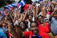 Hundreds of Cubans wave the national flags and express support for the regime of Fidel Castro and his brother Raul Castro during the annual celebration of the Cuban Revolution's beginning in Santiago de Cuba, Cuba, 26 July 2008. About 50 years after the national rebellion, led by Fidel Castro, and adopting the communist ideology shortly after the victory, the Caribbean island of Cuba is the only country in Americas having the communist political system. Although the Cuban state-controlled economy has never been developed enough to allow Cubans living in social conditions similar to the US or to Europe, mostly middle-age and older Cubans still support the Castro Brothers' regime and the idea of the Cuban Revolution. Since the 1990s Cuba struggles with chronic economic crisis and mainly young Cubans call for the economic changes.