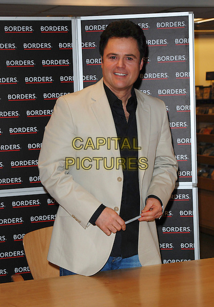 DONNY OSMOND.Signs copies of his new album in Borders Book Shop, Oxford Street, London, England, 9th March 2007..half length pen black shirt beige jacket .CAP/CAN.©Can Nguyen/Capital Pictures