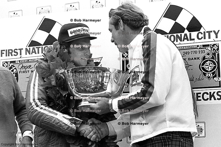 WATKINS GLEN, NY - OCTOBER 5, 1975: Austrian driver Niki Lauda receives the trophy in Victory Lane after winning the United States Grand Prix East race at the Watkins Glen Grand Prix Race Course on October 5, 1975 at Watkins Glen, New York.