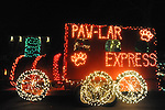 "The Crossroads Animal Clinic's ""Paw-Ler express"" float in the Christmas parade in Oxford, Miss. on Monday, December 3, 2012."