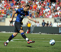 Manchester United forward Dimitar Berbatov (9) takes a shot on goal.  Manchester United defeated the Chicago Fire 3-1 at Soldier Field in Chicago, IL on July 23, 2011.