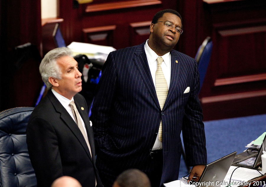 TALLAHASSEE, FLA. 5/6/11-SESSIONEND050611 CH-Rep. Perry Thurston, D-Plantation, right, and Rep. Jim Waldman, D-Coconut Creek, react during discussion of the education budget on the last day of the regularly scheduled session, Friday at the Capitol in Tallahassee..COLIN HACKLEY PHOTO
