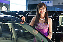 January 13, 2012, Chiba, Japan - A model smiles next to a custom car during the 2012 Tokyo Auto Salon at Makuhari Messe. The car show runs from January 13-15. (Photo by Christopher Jue/AFLO)