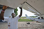 Gaston Ntambo, a United Methodist missionary, inspects a Cessna P210 in a hangar at an airstrip in Kamina in the Democratic Republic of the Congo. Ntambo and the plane are part of the Wings of the Morning aviation ministry of The United Methodist Church, and provide life-saving access to isolated rural communities.