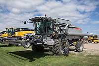 A New Holland Agriculture gleaner R76 combine is seen at a Mazergroup New Holland Agriculture dealership in Portage La Prairie, Manitoba, Monday August 17, 2015. New Holland Agriculture is  a global brand of agricultural machinery produced by CNH Industrial.