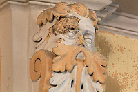 Sculptural detail of a face with vine leaves and scroll in the Royal Chapel, on the second floor of the Phare de Cordouan or Cordouan Lighthouse, built 1584-1611 in Renaissance style by Louis de Foix, 1530-1604, French architect, located 7km at sea, near the mouth of the Gironde estuary, Aquitaine, France. This is the oldest lighthouse in France. There are 4 storeys, with keeper apartments and an entrance hall, King's apartments, chapel, secondary lantern and the lantern at the top at 68m. Parabolic lamps and lenses were added in the 18th and 19th centuries. The lighthouse is listed as a historic monument. Picture by Manuel Cohen