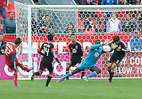 06 October 2012: D.C. United goalkeeper Bill Hamid #28 makes a save Toronto FC forward Andrew Wiedeman #32 during an MLS game between DC United and Toronto FC at BMO Field in Toronto, Ontario Canada. .D.C. United won 1-0..