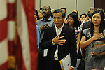 Shengkun Wen becomes a United States citizens during a naturalization ceremony in federal court in Oxford, Miss. on Friday, June 29, 2012. Forty seven persons took the oath of citizenship.