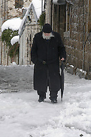 An Israeli old man walk during snow storm in Jerusalem. December 13, 2013.  Photo by Oren Nahshon