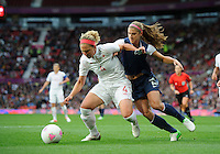 Manchester, England - Monday, August 6, 2012: The USA defeated Canada 4-3 in overtime in the semi-final round of the 2012 London Olympics at Old Trafford. Alex Morgan (13) and Carmelina Moscato (4) battle for the ball.