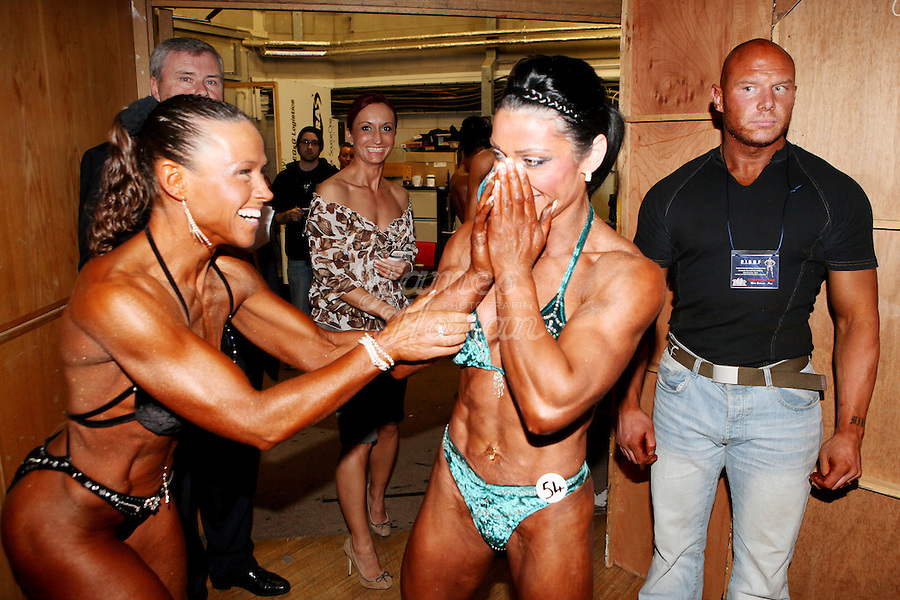 23/10/2010. Irish female physique and figure fitness national championships.  Margaret Mc Grath from Carlow congratulates Sophia Mc Namara (1st place winner) from Limerick  backstage during the female physique category as part of the 2010 RIBBF national bodybuilding championships at the University of Limerick Concert Hall, Limerick, Ireland. Picture James Horan