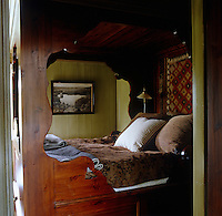 A bedroom of a house in Norway is dominated by a huge traditional box bed, a haven in the cold winter months