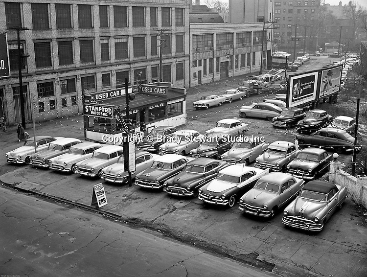 Pittsburgh PA:  View of Stanford Motors Used Car lot in the East Liberty section of Pittsburgh - 1956