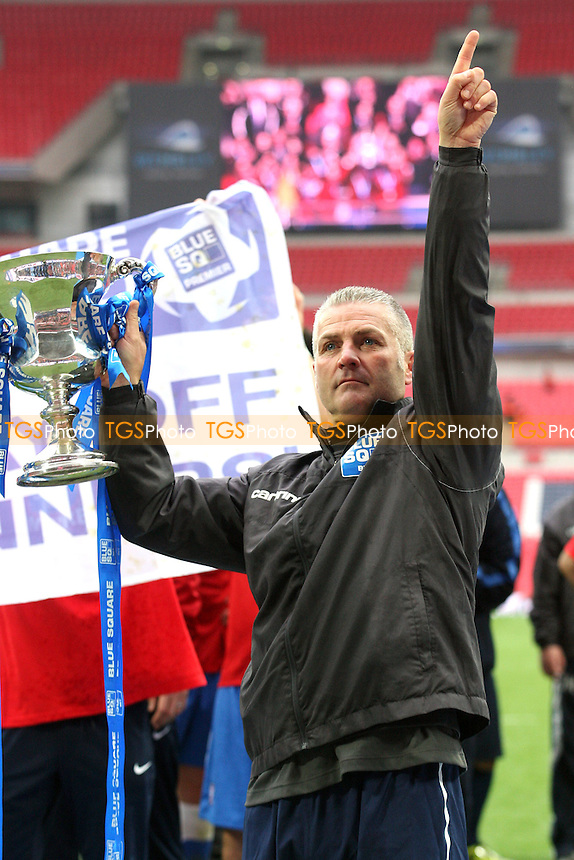 York City manager Gary Mills points the way up with the Blue Square Bet Promotion Trophy -  Luton Town vs York City at the Wembley National Stadium - 20/05/12 - MANDATORY CREDIT: Dave Simpson/TGSPHOTO - Self billing applies where appropriate - 0845 094 6026 - contact@tgsphoto.co.uk - NO UNPAID USE.