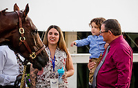 HALLANDALE, FL JANUARY 28: Alan Sherman, with his grandson Logan in his arms, checks in on California Chrome after his poor performance in the $12,000,000 Pegasus World Cup Invitational at Gulfstream Park Race Course on January 28, 2017 in Hallandale Beach, Florida. (Photo by Arron Haggart/Eclipse Sportswire/Getty Images)