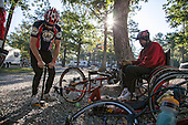 Steve Taylor and Glenn Fretz prep their hand cycles for the day's ride.