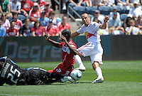 New York midfielder Joel Lindpere (20) shoots past Chicago defender Yamith Cuesta (89) and goalkeeper Sean Johnson (25) to score New York's only goal.  The Chicago Fire tied the New York Red Bulls 1-1 at Toyota Park in Bridgeview, IL on June 26, 2011.