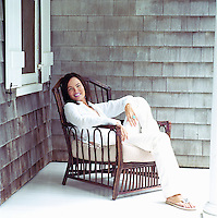 Portrait of designer Nanette Brown relaxing in a chair on her porch