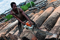 A Colombian worker uses a chainsaw to cut a log from the rainforest at a sawmill in Tumaco, Colombia, 14 June 2010. Tens of sawmills located on the banks of the Pacific jungle rivers generate almost half of the Colombia's wood production. The wood species processed here (sajo, machare, roble, guabo, cargadero y pacora) are mostly used in the construction industry and the paper production. Although the Pacific lush rainforest in Colombia is one of the most biodiverse area of the world, the region suffers an extensive deforestation due to the uncontrolled logging in the last years.