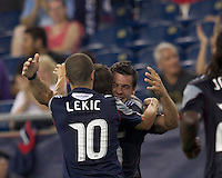 New England Revolution forward Milton Caraglio (9) celebrates his goal with teammates. In a Major League Soccer (MLS) match, the New England Revolution tied New York Red Bulls, 2-2, at Gillette Stadium on August 20, 2011.