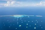 Toau Atoll, Tuamotu Archipelago, French Polynesia; aerial views of the Toau Atoll while flying from Rangiroa south to Fakarava