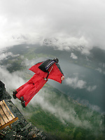 A jumper exits from the top of the mountain. World BASE Race held in Innfjorden, Norway, where BASE jumpers in wingsuits compete in flying down the mountain. The winner is called the World's Fastest Flying Human Being..©Fredrik Naumann/Felix Features.