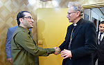 Iraq's Deputy Interior Minister Aqeel al-Khazali (left) greets Anglican Bishop John Christopher Cocksworth of Coventry, England, during the visit of an ecumenical delegation to al-Khazali's office in Baghdad on January 21, 2017.