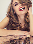 Portrait of a beautiful young laughing woman with glamorous hair