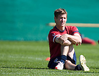 Brian McBride stretches before training in Hamburg, Germany, for the 2006 World Cup, June, 8, 2006.