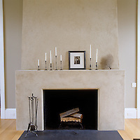The monumental contemporary fireplace in the kitchen/dining area is of a simple yet elegant design