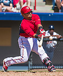 16 March 2014: Washington Nationals catcher Jhonatan Solano singles during a Spring Training Game against the Detroit Tigers at Space Coast Stadium in Viera, Florida. The Tigers edged out the Nationals 2-1 in Grapefruit League play. Mandatory Credit: Ed Wolfstein Photo *** RAW (NEF) Image File Available ***