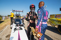 Oct 16, 2016; Ennis, TX, USA; NHRA top fuel driver Steve Torrence (left) talks with race winner Antron Brown during the Fall Nationals at Texas Motorplex. Mandatory Credit: Mark J. Rebilas-USA TODAY Sports