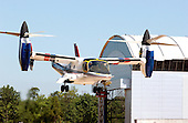 """The XV-15 tilt rotor aircraft took its place in what could be called """"aviation's hall of fame,"""" when NASA and the U.S. Army transferred the vehicle to the National Air and Space Museum's new Steven F. Udvar-Hazy Center near Washington Dulles International Airport in Herndon, Virginia on September 16, 2003.  Tilt rotors are a unique type of aircraft that possess the take-off, hover and landing capabilities of a conventional helicopter with the range and speed of a turboprop aircraft.  Tilt rotor flight research began in the 1950s with the Bell XV-3 convertiplane.  NASA's Ames Research Center, Moffett Field, Calif., in partnership with the U.S. Army, developed design specifications for a new aircraft to demonstrate the viability of the tilt rotor concept.  After extensive ground, wind tunnel and simulator tests at Ames, the first of two XV-15s, built by Bell Helicopter Textron, took its maiden flight on May 3, 1977.  The success of the XV-15 has led to the development of the V-22 Osprey and the world's first civil tilt rotor, the nine-passenger Bell Agusta 609, now under development and scheduled for deliveries in 2007.  The National Air and Space Museum, comprised of the Udvar-Hazy Center, which is scheduled to open to the public on December 15, 2003, and the museum's building on the National Mall, .will be the largest air-and-space-museum complex in the world. .Credit: Ron Sachs / CNP"""