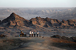 Africa, Namibia, Swakopmund. Sundowner in the Moon Landscape of Namib Desert east of Swakopmund.